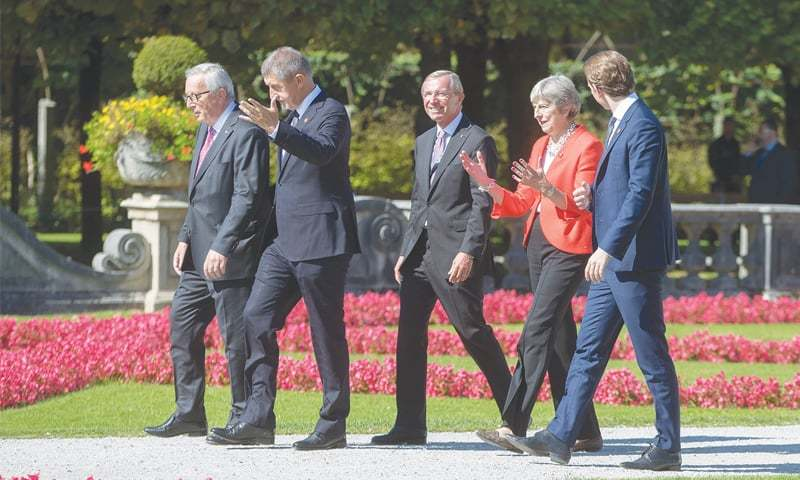(Left to right) European Commission President Jean-Claude Juncker, Czech Prime Minister Andrej Babis, Austrian politician Wilfried Haslauer, Britain's Prime Minister Theresa May and Austrian Chancellor Sebastian Kurz walk after posing for a family photo during the EU informal summit in Salzburg on Thursday.—AFP