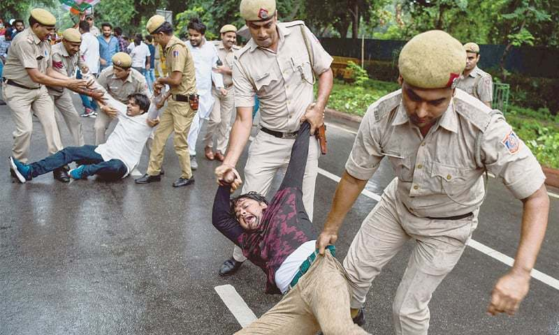 NEW DELHI: Supporters of the Indian Youth Congress shout slogans as police detain them during a protest on Saturday against the government of Prime Minister Narendra Modi for being involved in corruption in the Rafale jets deal.—AFP