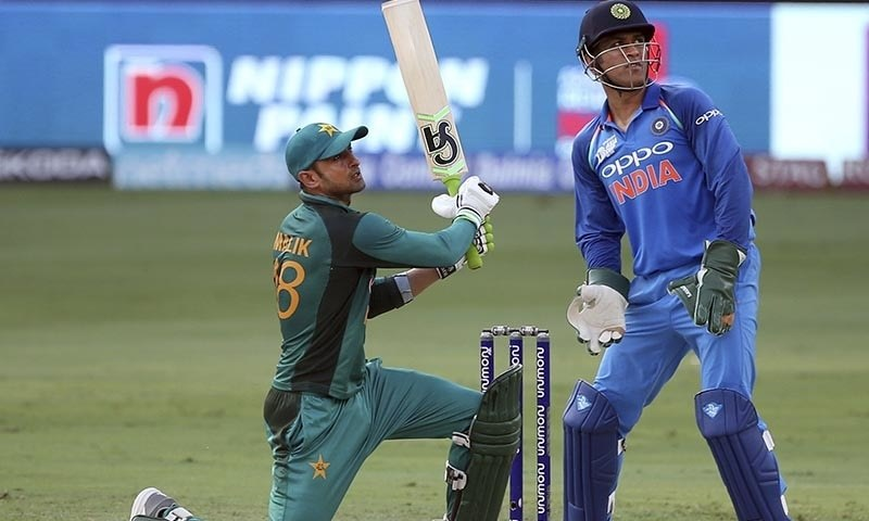 Shoaib Malik, left, watches the ball after hitting a six — AP