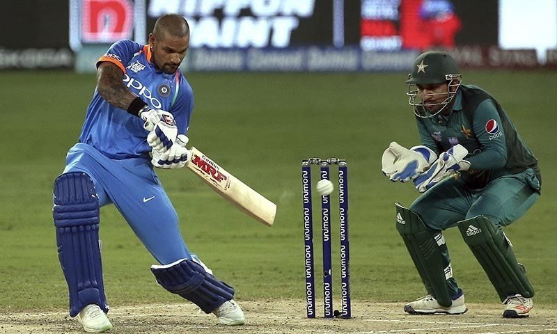 Shikhar Dhawan, left, bats during the Asia Cup match between India and Pakistan — AP