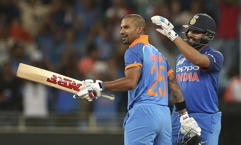 India's captain Rohit Sharma, right, congratulates teammate Shikhar Dhawan on scoring a century. — AP