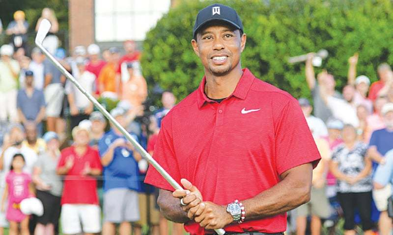 Woods earns first win since 2013; Rose claims FedEx Cup