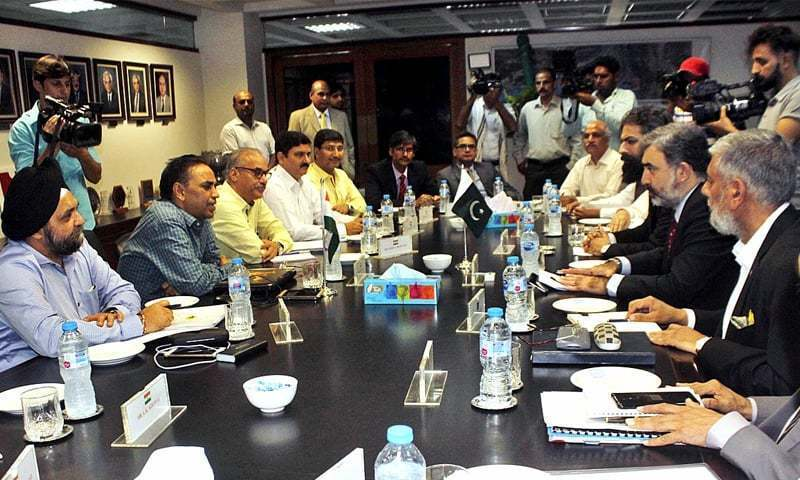 LAHORE: Pakistan's Commissioner for Indus Waters Syed Muhammad Mehar Ali Shah and members of his team talk to Indian Indus Water Commissioner Pradeep Kumar Saxena and other members of his delegation during a meeting last month.— APP/File