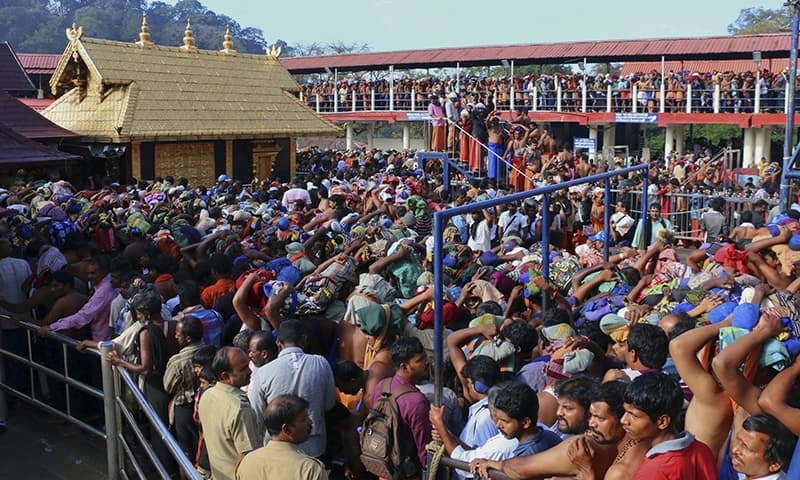 In this Dec 1, 2015 photo, Hindu worshippers queue during a pilgrimage at the Sabarimala temple in the southern Indian state of Kerala. — AP