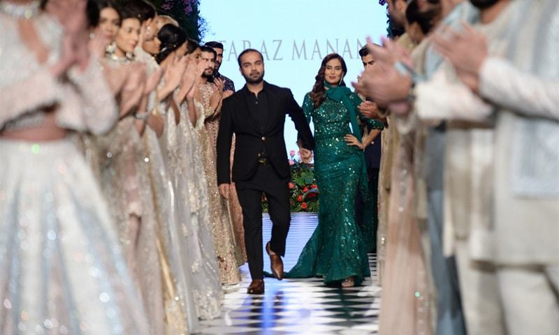 Faraz Manan takes his bow with model Mehreen Syed as the opening act on the last day of the PFDC L'Oreal Paris Bridal Week - Photo: Faisal Farooqui @ Dragonfly