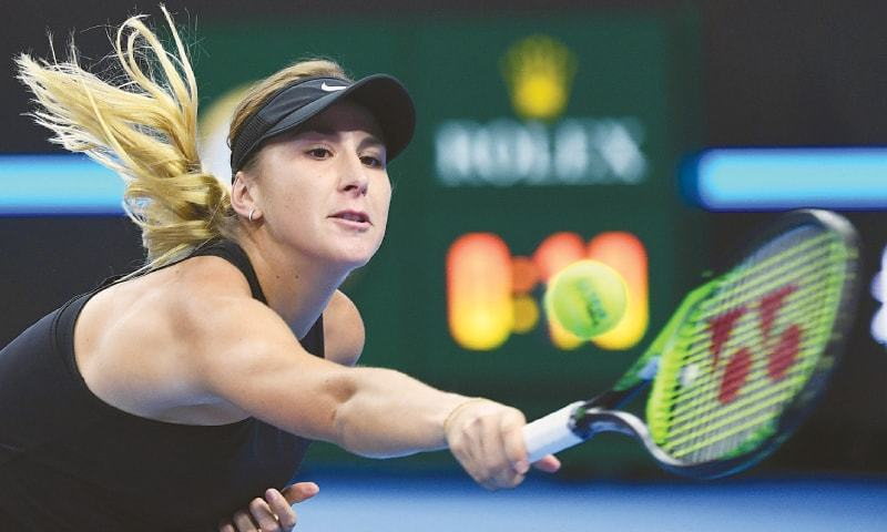 Belinda Bencic of Switzerland hits a return to Denmark's Caroline Wozniacki during their first-round match at the China Open on Monday. — AFP