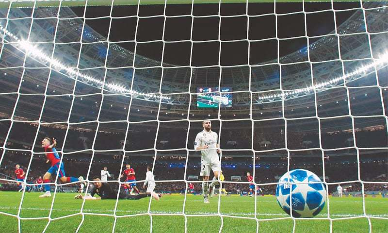 MOSCOW: Real Madrid goalkeeper Keylor Navas fails to stop a shot by CSKA Moscow's Nikola Vlasic during (L) during their UEFA Champions League Group 'G' match at the Luzhniki Stadium.—AP