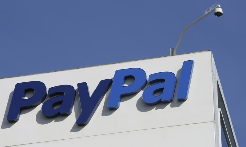 This file photo shows the logo for PayPal which owns the Xoom money transfer service.