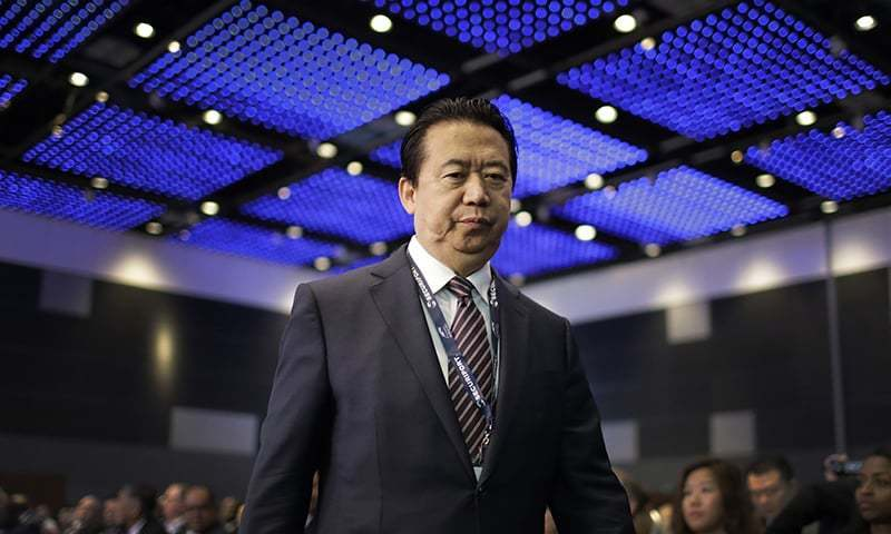 Interpol President Meng Hongwei walks toward the stage to deliver his opening address at the Interpol World congress. — AP