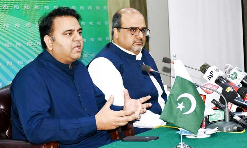 Information Minister Fawad Chaudhry and Special Assistant to the Prime Minister on Accountability Shahzad Akbar address a joint press conference in Islamabad. ─PID