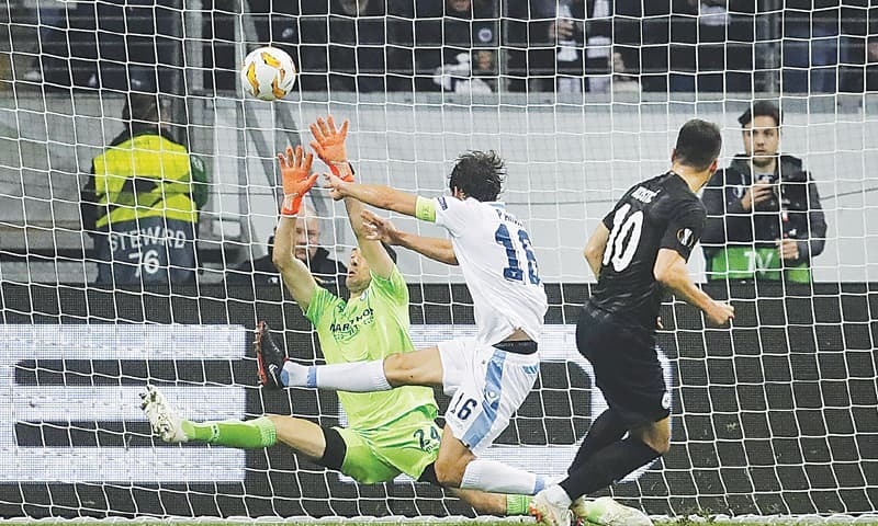 FRANKFURT: Eintracht Frankfurt's Filip Kostic (R) scores during the Europa League Group 'H' match against Lazio.—AP