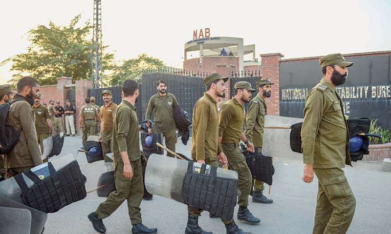 A contingent of police pictured outside the NAB office in Lahore on Friday.—Murtaza Ali / White Star