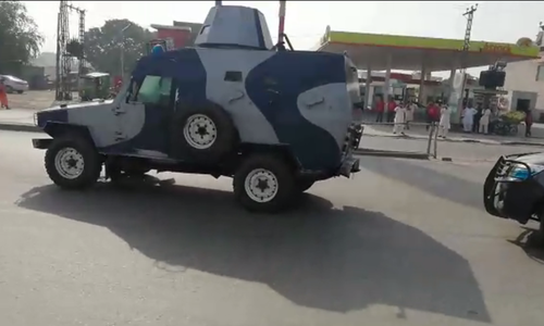 An armoured vehicle included in PML-N president's security squad as he is being taken to the accountability court. — DawnNewsTV
