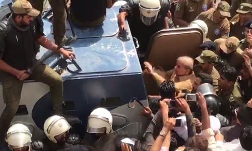 Shabaz leaves the accountability court following the hearing. — DawnNewsTV