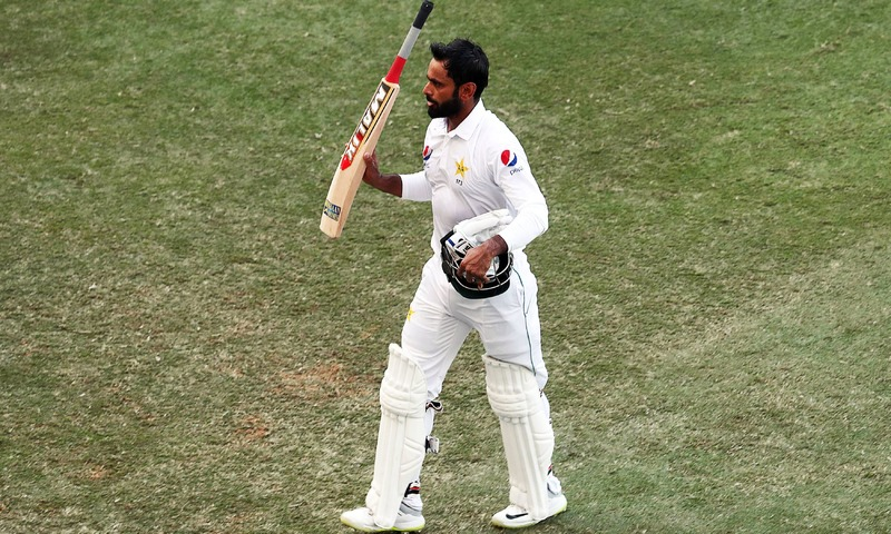 Mohammad Hafeez leaves the field on day one of the 1st Test cricket match between Australia and Pakistan at the Dubai International Cricket Stadium. —AFP