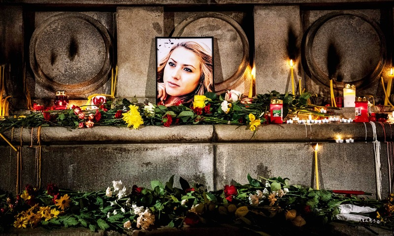 This picture shows a portrait of slain Bulgarian television journalist Viktoria Marinova during in a candle-light vigil in the city of Rousse. —AFP