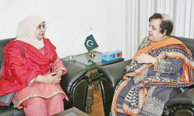 Minister for Human Rights Dr Shireen Mazari talks to Chairperson Defence of Human Rights and Public Service Trust Amina Masood on Monday. — INP