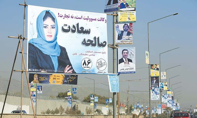 Posters for Afghanistan's parliamentary elections on display over a street during the first day of the campaign in September. — File Photo/AP