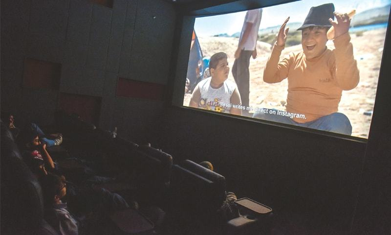 YOUNGSTERS enjoy a movie during the festival on Wednesday.—White Star