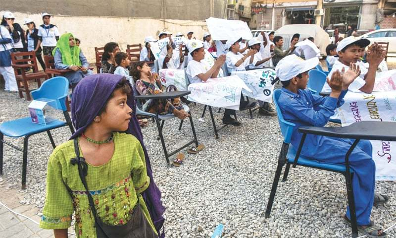 Little Hassani (in green) ponders joining other kids during a class on Wednesday.—Fahim Siddiqi / White Star