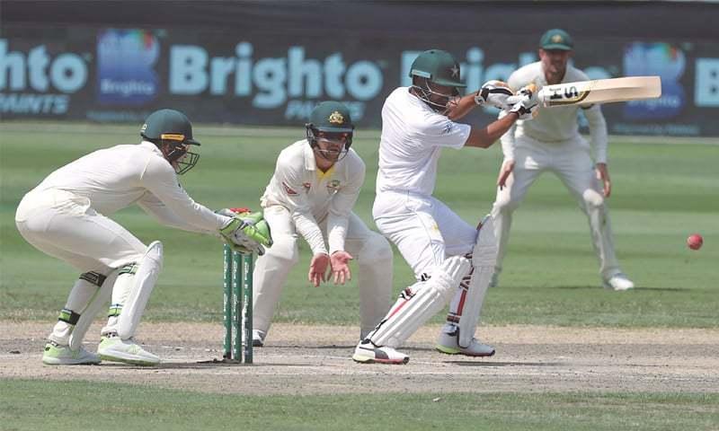 DUBAI: Pakistan batsman Babar Azam plays a shot during the first Test against Australia at the Dubai International Cricket Stadium on Wednesday.—AFP