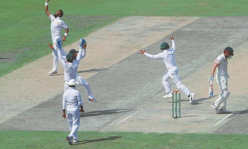 Pakistan off-spinner Bilal Asif (L) celebrates with team-mates after taking the wicket of Australian opener Usman Khawaja during the first Test at the Dubai International Cricket Stadium on Tuesday. — File Photo / AFP