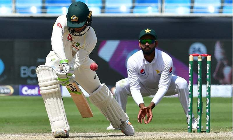 Australian cricketer Usman Khawaja (L) plays a shot during the fifth day of play of the first Test cricket match in the series between Australia and Pakistan at the Dubai International Stadium. — AFP