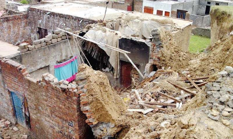 Roof of two adjacent houses pictured collapsed in Bajaur. —File photo