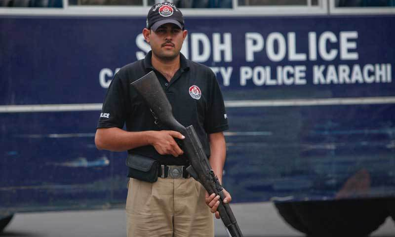 A policeman stands alert in Karachi in this file photo.