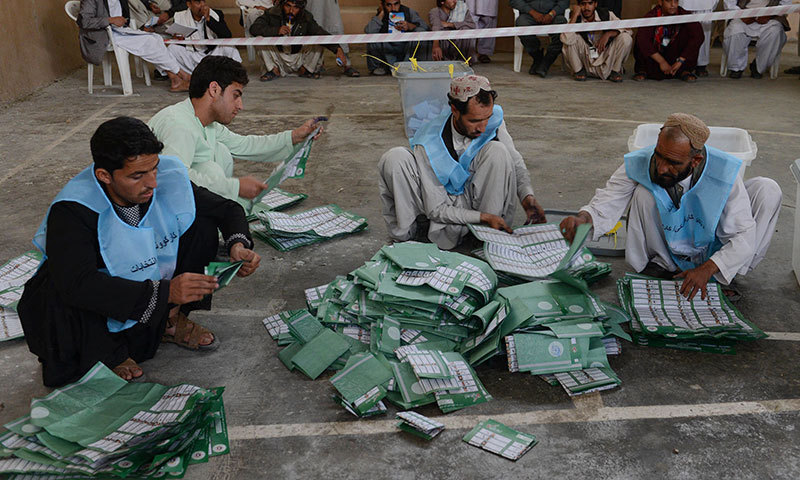 ECP personnel counting votes — File