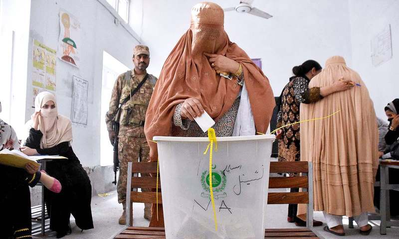 APP08-14 PESHAWAR: October 14 - A lady cast her vote at polling station during by-election in PK-78. APP photo by Shaheryar Anjum