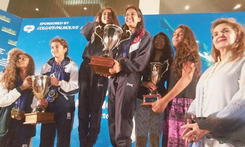 KARACHI: The captains and vice-captains of top three winners with their trophies pose with the first lady Begum Samina Arif Alvi.—SH