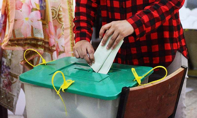 A woman casts her ballot during the by-election in Lahore on October 14. ─ AFP