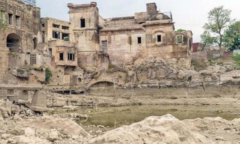 File photo shows Katas Raj temple's pond that had dried up due to consumption of water by cement factories near Chakwal.