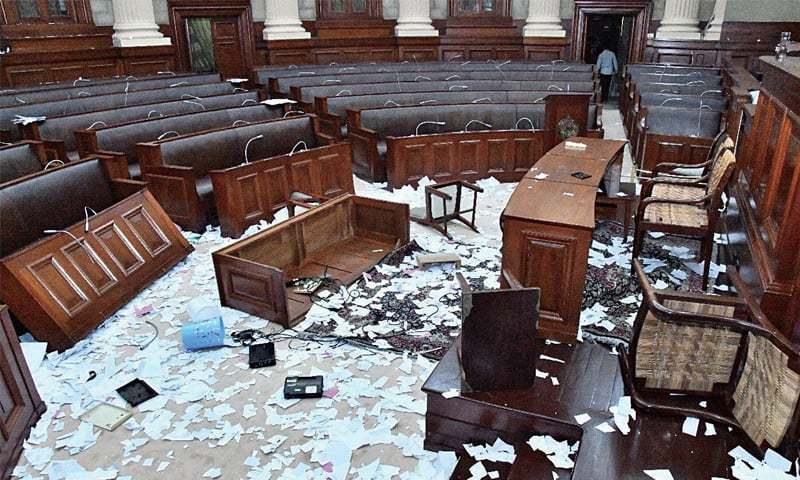 This photograph of the Punjab Assembly premises shows damaged furniture and torn up copies of the budget after Tuesday's rowdy session. ─ Dawn/File