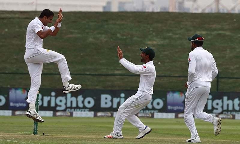 Mohammad Abbas (L) celebrates after dismissing Australian cricketer Travis Head. — AFP