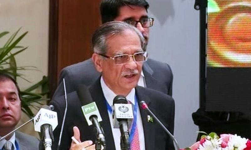 Chief Justice Mian Saqib Nisar addresses a symposium. — DawnNewsTV