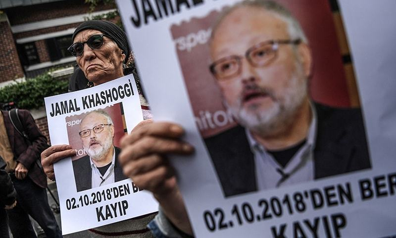 """Protesters holding portraits of missing journalist and Riyadh critic Jamal Khashoggi with the caption: """"Jamal Khashoggi is missing since October 2"""". —AFP"""