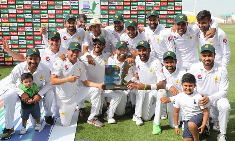 Pakistan cricket team celebrates at the end of day four of the second Test match between Australia and Pakistan. — AFP