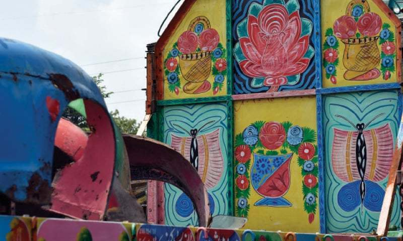 Painting a colourful portrait of a young girl with books in her arms and a message advocating female education, truck artist Hayat Khan said he now finds satisfaction in his work. — File Photo