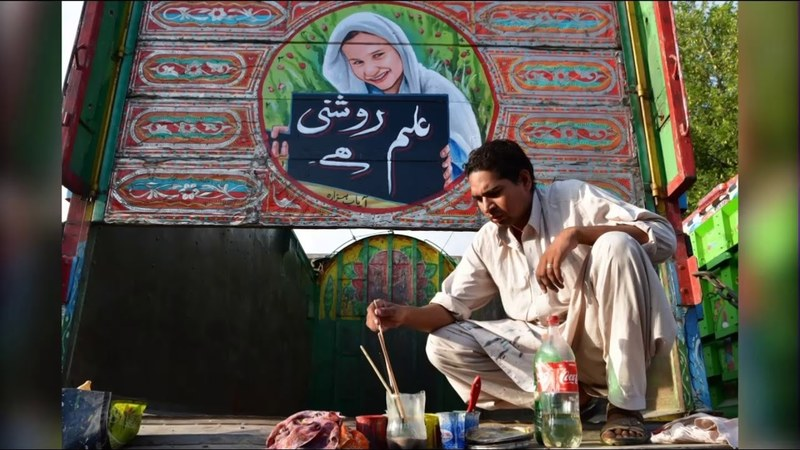 Hayat Khan paints portraits of school-going girls on trucks with messages against child marriages  - Screengrab