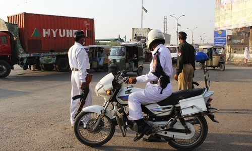 Traffic policemen are seen in this file photo.— File