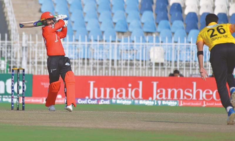 Lahore Blues' opener Ahmed Shehzad strikes a powerful blow during his whirlwind innings against Peshawar in the National T20 Cup match at the Pindi Cricket Stadium in 2017. — File Photo
