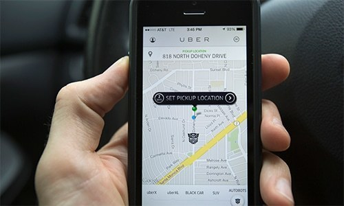This file photo shows the interface of a ride-sharing app. —File