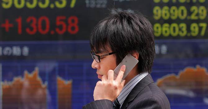 Trader at Tokyo Stock Exchange — File Photo