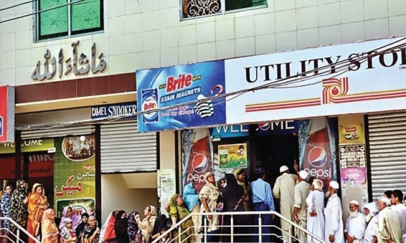 This file photo shows citizens lining up outside utility stores to buy subsidised groceries.
