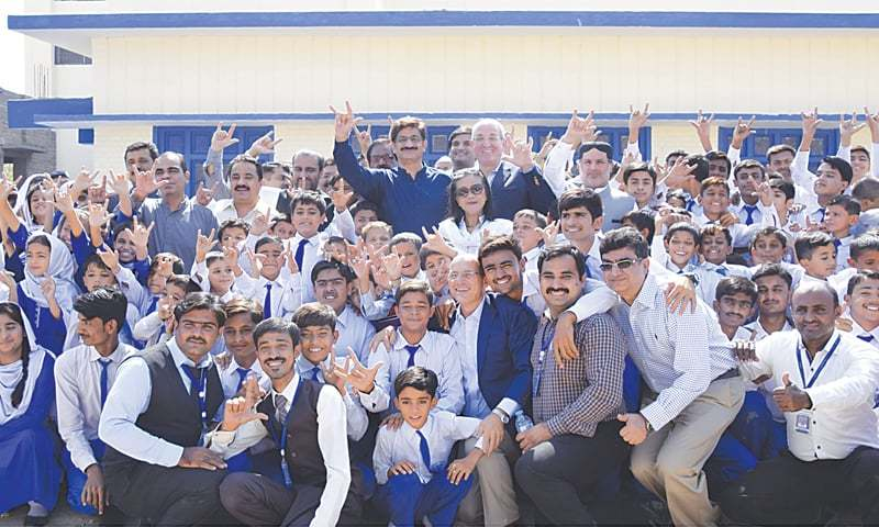 SPECIAL students pose for a group photo with CM Murad Ali Shah at the Deaf Reach School in Sukkur on Tuesday.—Dawn