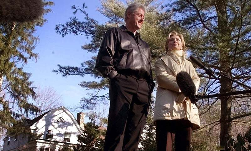 In this January 6, 2000 file photo, Bill and Hillary Clinton stand in the driveway of their new home in Chappaqua, NY. —AP