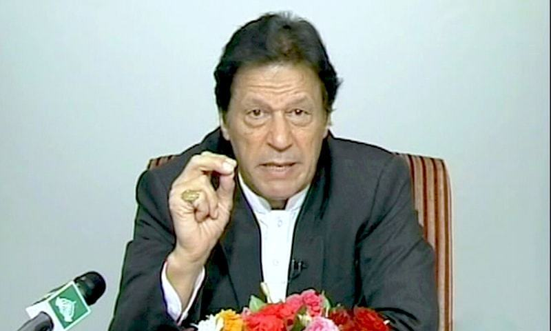 Prime Minister Imran Khan delivers a televised address to the nation. — DawnNewsTV