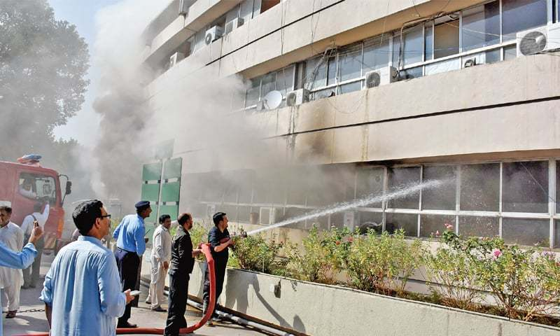 Firefighters put out the fire at the PID building on Wednesday. — Photo by Tanveer Shahzad